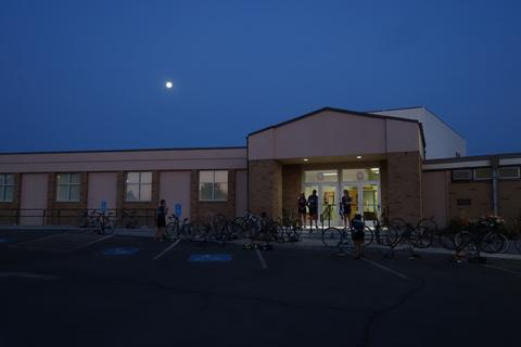 Preparing bikes for the day in the moonlight