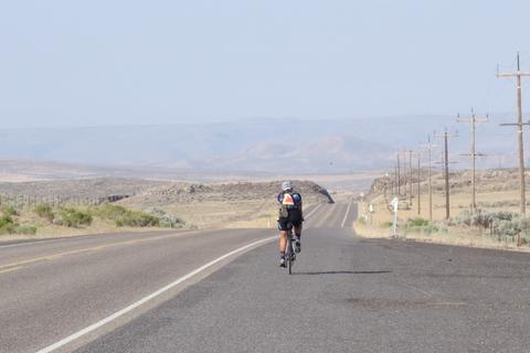 Helen on the road, with nothing in sight.