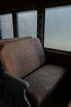 One of the seats on the train. It's a little worse fof wear but not ruined with age.