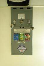 A condom dispenser at a gas station.